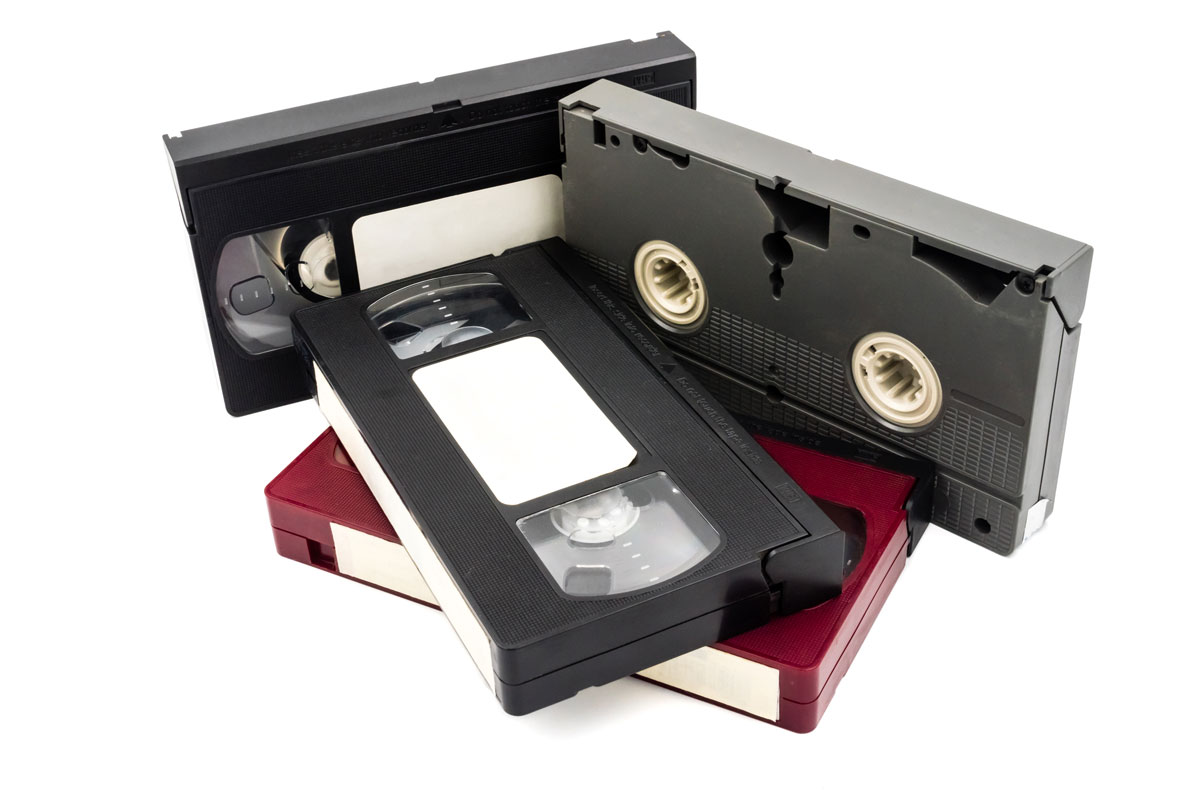 Four VHS tapes on white background