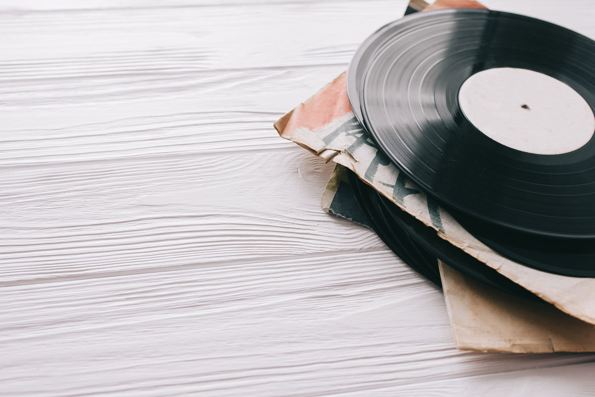 Pile of vinyl records on wooden background