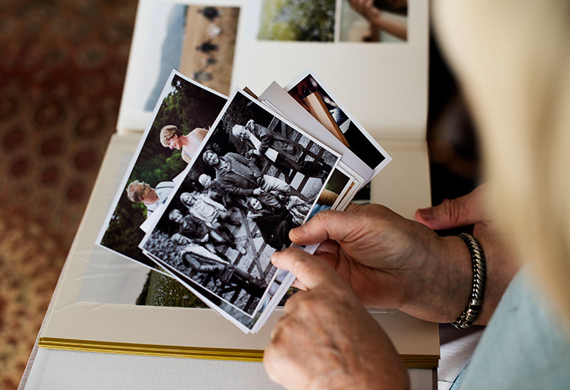 Lady looking at old photos